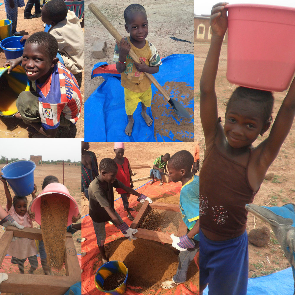 The whole community took part in the production of their BioSand Filters! The kids prepared the sand.