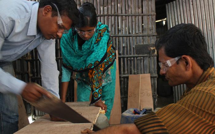 Asit, Sabina, & Hasan building the Wood Mold.