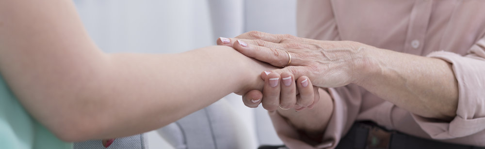 doctor-touches-her-patient-hand-PXV9KE7.jpg