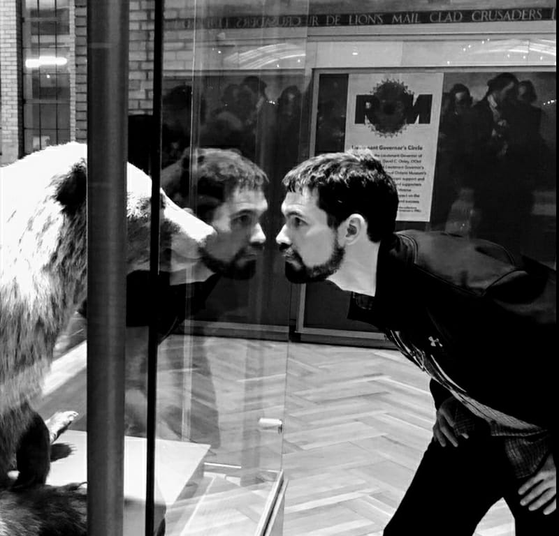 The Beast in the Glass - One day while I was wanderingThe hallways long and deepI found a prism prisoner A vicious, glass-bound beastHis eyes were bright and dangerousHis mouth, a hungry beakAnd as I pondered this new foeI saw he pondered meOh graceful glass! Oh precious pane!Oh what relief to beA space apart from rending jawsAnd talons of the beastI dread to think, I shun to knowWhat horror I would seeWithout that flawless sheet of glassBetween the beast and me