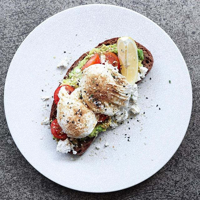 Toss the apple; an avo a day keeps the doctor away, smeared on miche sourdough with cherry toms, feta and those #eggporn kinda poached eggs.