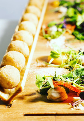 A canapé is a type of hors d'œuvre, a small, prepared and usually decorative food, consisting of a small piece of bread, puff pastry, or a cracker topped with some savoury food, held in the fingers and often eaten in one bite.     We are experts at providing presentable and delicious canapés for varied audiences.Text here...