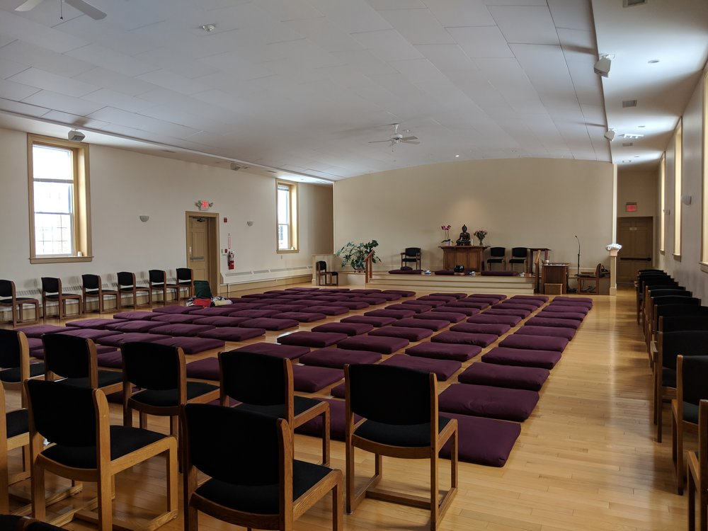 The Meditation Hall. See the cushion with the chair back and blankets on it? Count four behind it and that's where I was parked for many hours.
