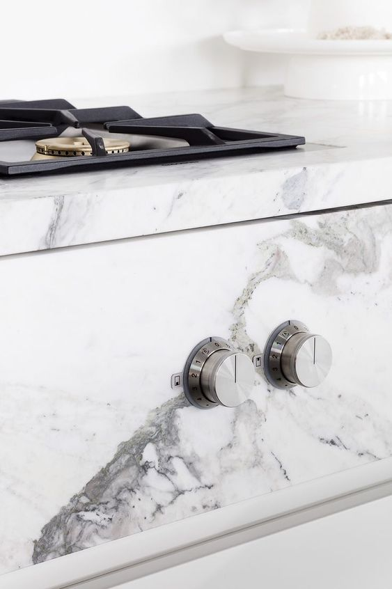 INTEGRATED COOKER - Knobs & Cooker are beautifully embedded in the marble
