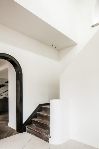 contrasting shapes - The mix of old and new, straight and curved angles has given character to this 1930's villa