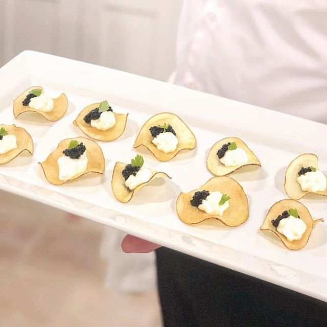 A classic and incontrovertibly delicious combo - homemade kettle cooked potato chips topped with crème fraîche and caviar.