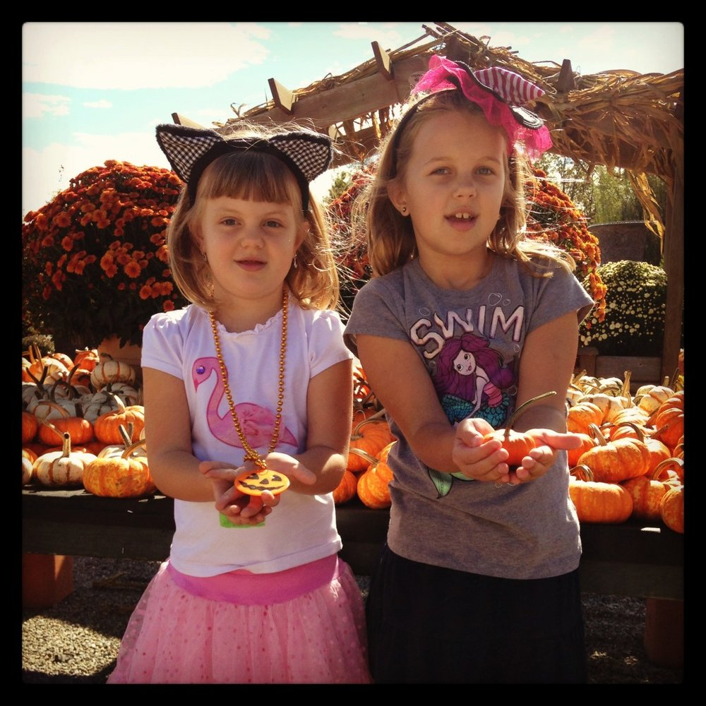 Zoe & Ana Picking Pumpkins