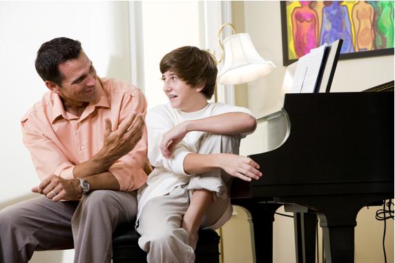 dad and son at piano