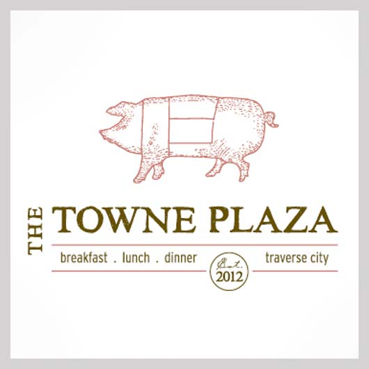 Towne Plaza - Contemporary eatery with a leafy outdoor seating area, featuring a seasonal, pork-centric menu.(231)929-0900
