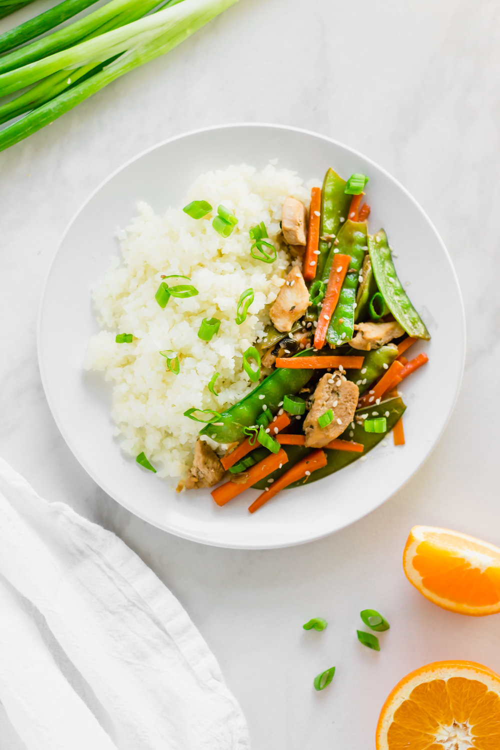 This Chicken Teriyaki Stir Fry is extra delicious thanks to an easy teriyaki sauce that completely makes the dish. The best part? The teriyaki sauce only requires five ingredients! #healthy #midweekminimalist