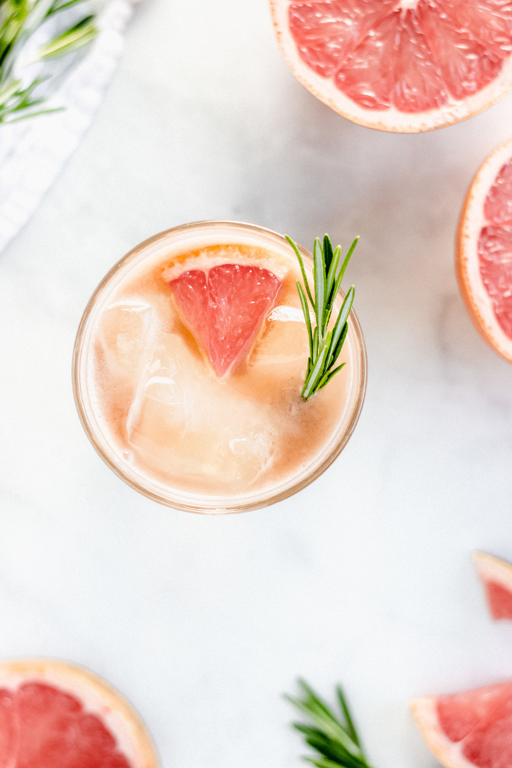 Ruby Boulevard - A refreshing whiskey based cocktail enhanced with fresh grapefruit and rosemary  honey simple syrup