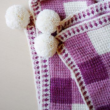 TL YARN CRAFTSSweet Gingham Baby Blanket - Brings together your favorite techniques: Tunisian crochet, traditional crochet, & pom poms!$5.00