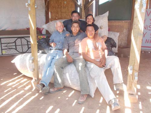the crew sitting on the nine wool bags of Peace Fleece Navajo.