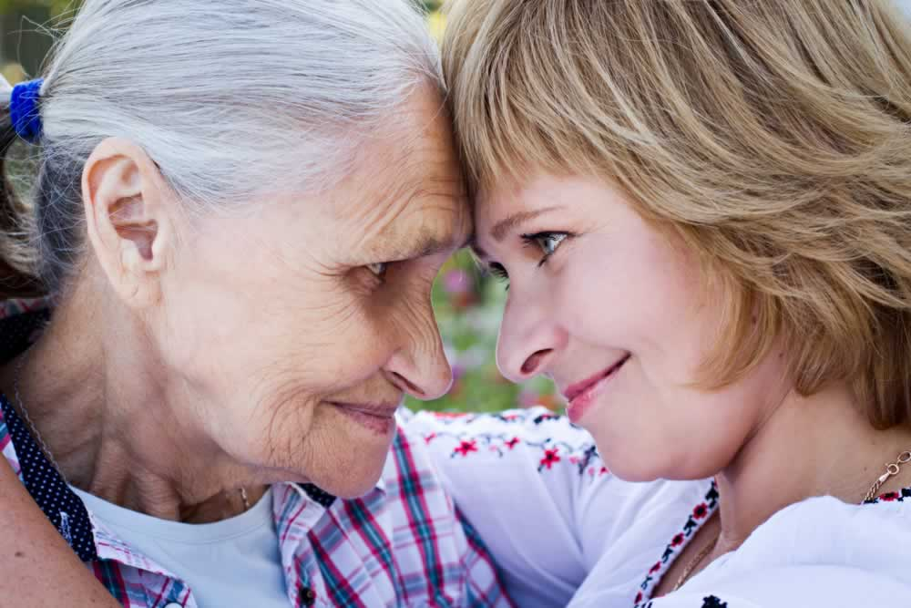 helping-hands-care-for-the-elderly-concept-closeup-senior-and-caregiver-holding-hands-at-home