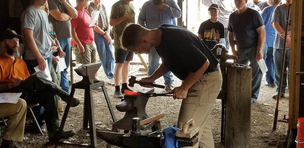 teaching bladesmithing.JPG