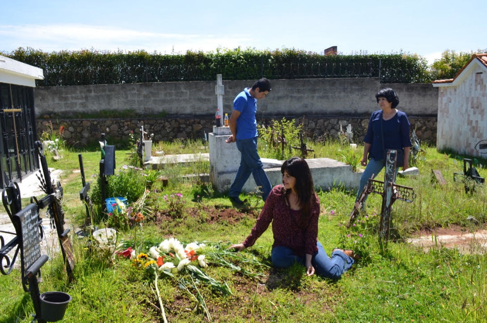 Tyaga at her biological mother's grave outside Mexico City in 2015.