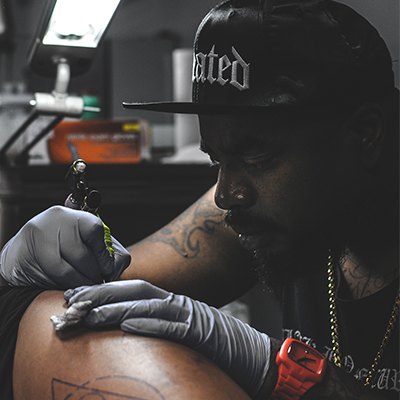 SLOWDEATH - A.K.A. BJ StormsSpecializes in Black & Grey Single-Needle Tattoo Work.- The Baker