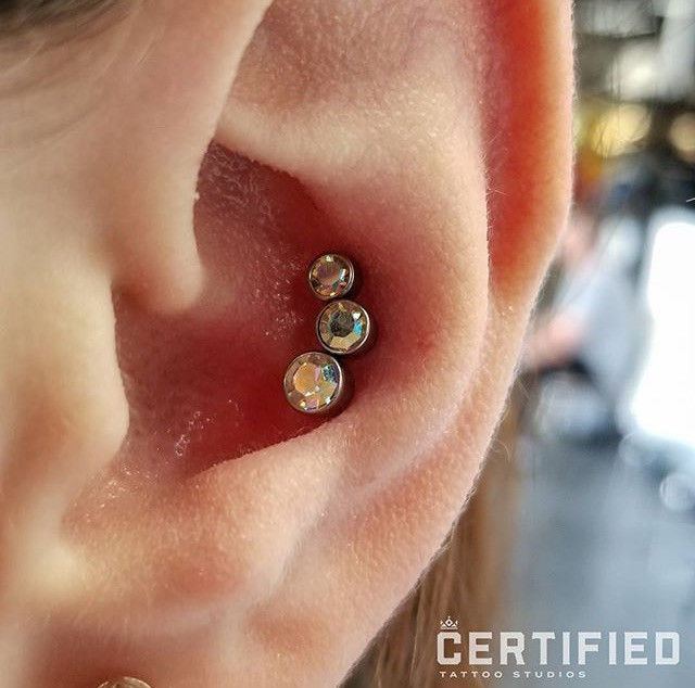 Conch Piercing by Isacc at Certified Tattoo Studios Denver, Colorado's Tattoo Studio.jpg