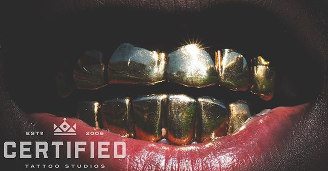 """Never Regret Anything That Made You Smile."" - Mark Twain ✨😁✨ Certified Tattoo Studios is Colorado's leading retailer of custom made Grillz! We offer hands-on services for everything from design consultations to mold processing to your final fitting once your grill has been delivered to our studio! Stop into our 1559 S. Broadway location to start creating your one of a kind grill! ------------------------------------------------------ #tattoos #tattooart #tattooer #tattoo #tattooartist #tattooed #denver #tattooing #tatuaje #topclasstattooing #art  #tattooidea #beauty #style #love #today #piercings #piercing #bodyjewelry #jewelry #grillz #gold #smile"