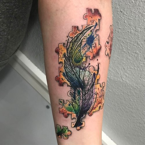 Color Feather Tattoo by Darious at Certified Tattoo Studios.jpg