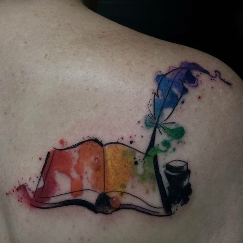 Water Color Book Tattoo by Jeff at Certified Tattoo Studios.jpg
