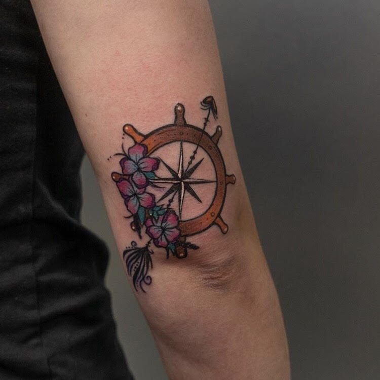 Custom Cartoon Style Ship Wheel and Flowers Tattoo by Hannah at Certified Tattoo Studios Denver CO.jpg