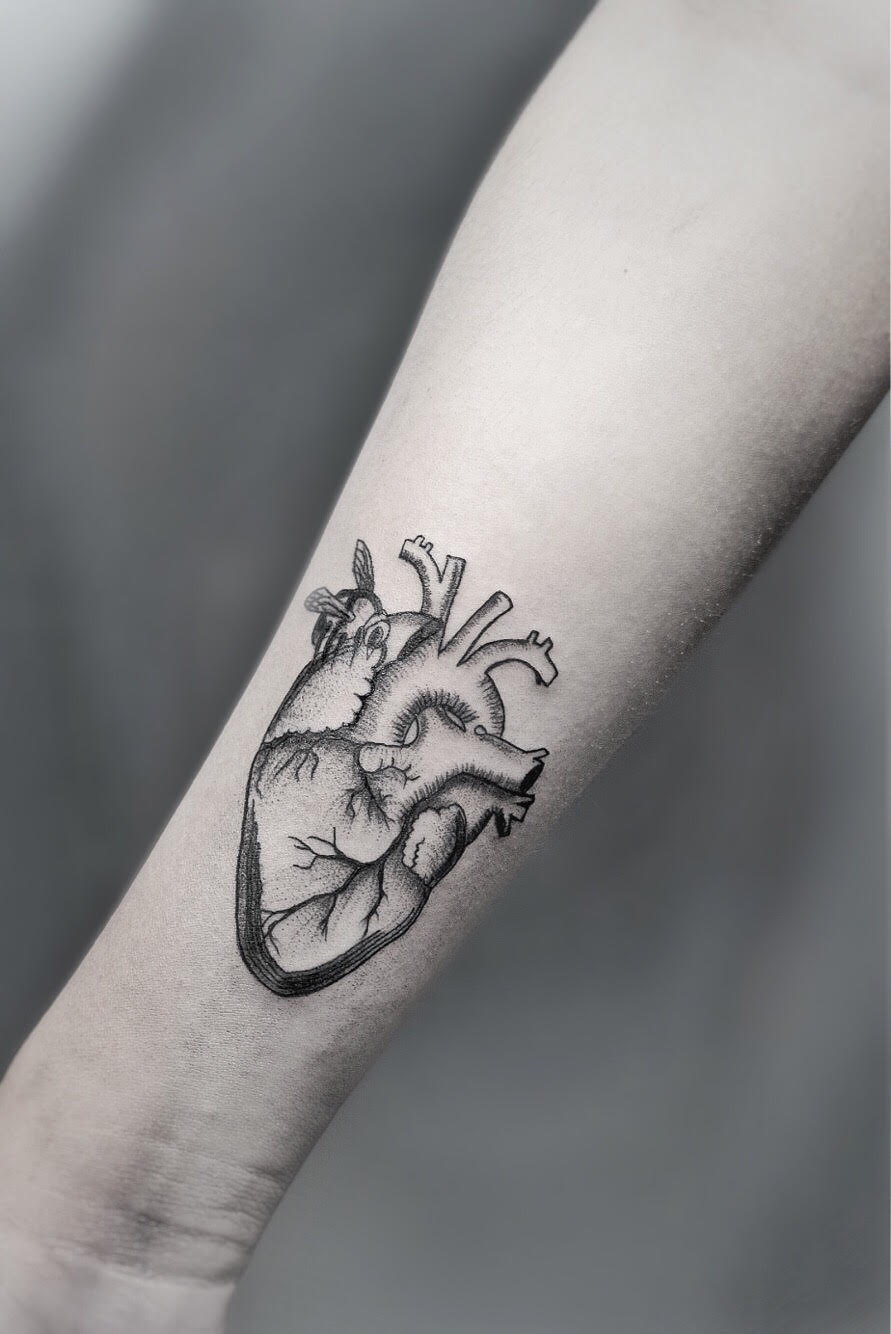 Custom Black and Grey Dot Work Human Heart and Bumble Bee by Dani at Certified Tattoo Studios Denver Co.jpg