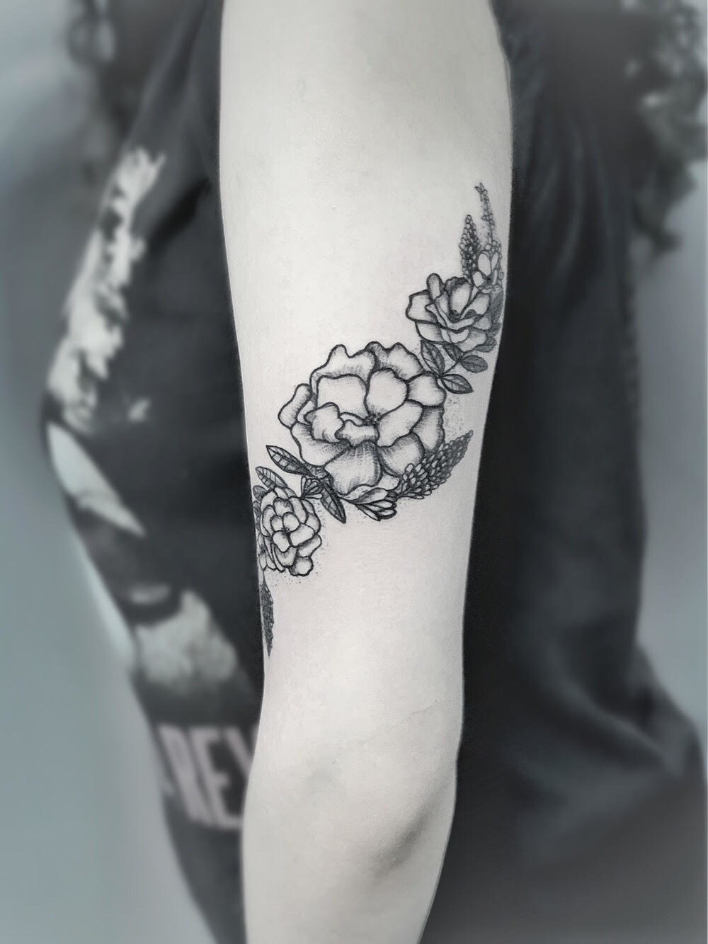 Custom Black and Grey Flowers Wrapping the arm Tattoo by Dani At Certified Tattoo Studios Denver Co.jpg