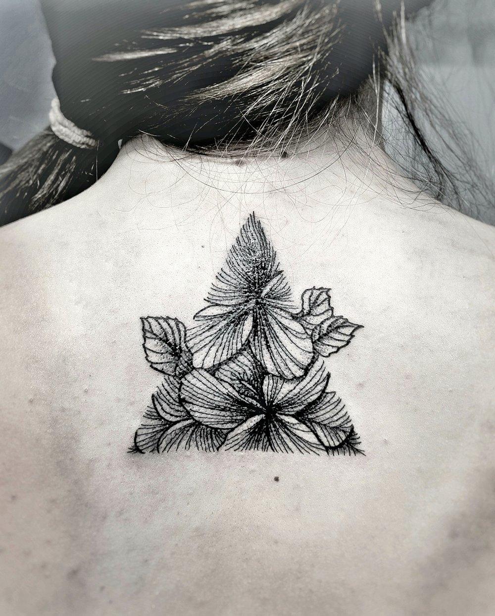 Custom Black Work Hibiscus Flowers inside a Trianlge Tattoo by Dani at Certified Tattoo Studios Denver Co.jpg