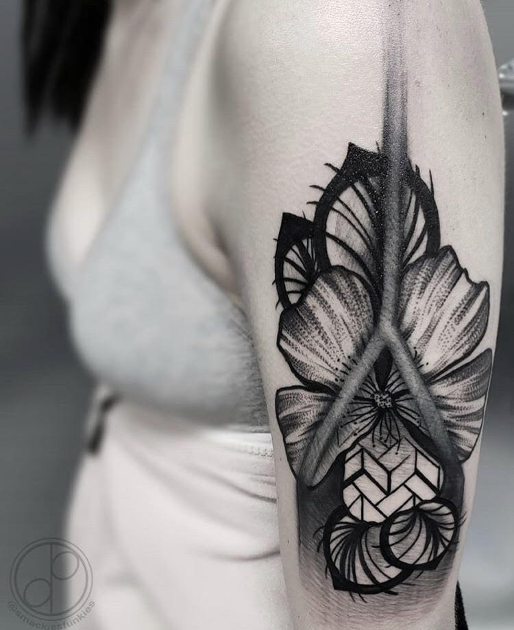 Custom Black and Grey Geometric Columbine Flower Tattoo by David at Certified Tattoo Studios Denver Co.jpg