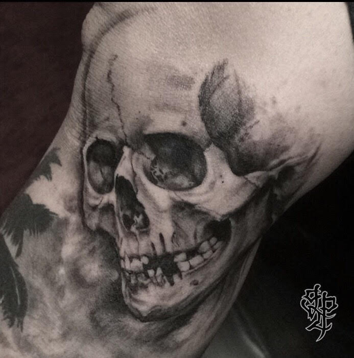 Custom Black and Grey  Skull Tattoo by Greg Paquin at Certified Tattoo Studios Denver Co.jpg