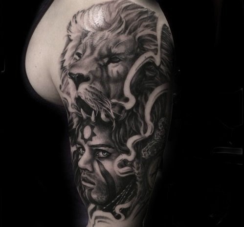 Custom Black and Gray Lion and Person Tattoo by Greg at Certified Tattoo Studios Denver Co.jpg