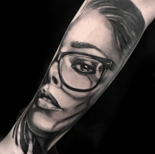 Custom Black and Gray Rihanna Portrait tattoo by Greg at Certified Tattoo Studios Denver Co.jpg