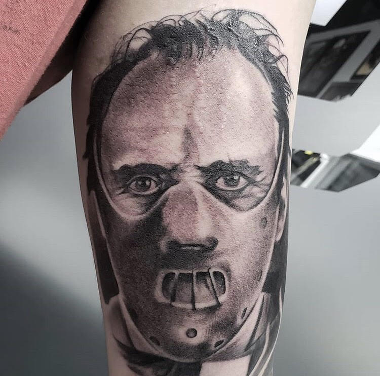 Custom Black and Grey Hannibal Lecter silence of the Lambs Tattoo by Piper at Certified Tattoo Studios Denver CO.jpg