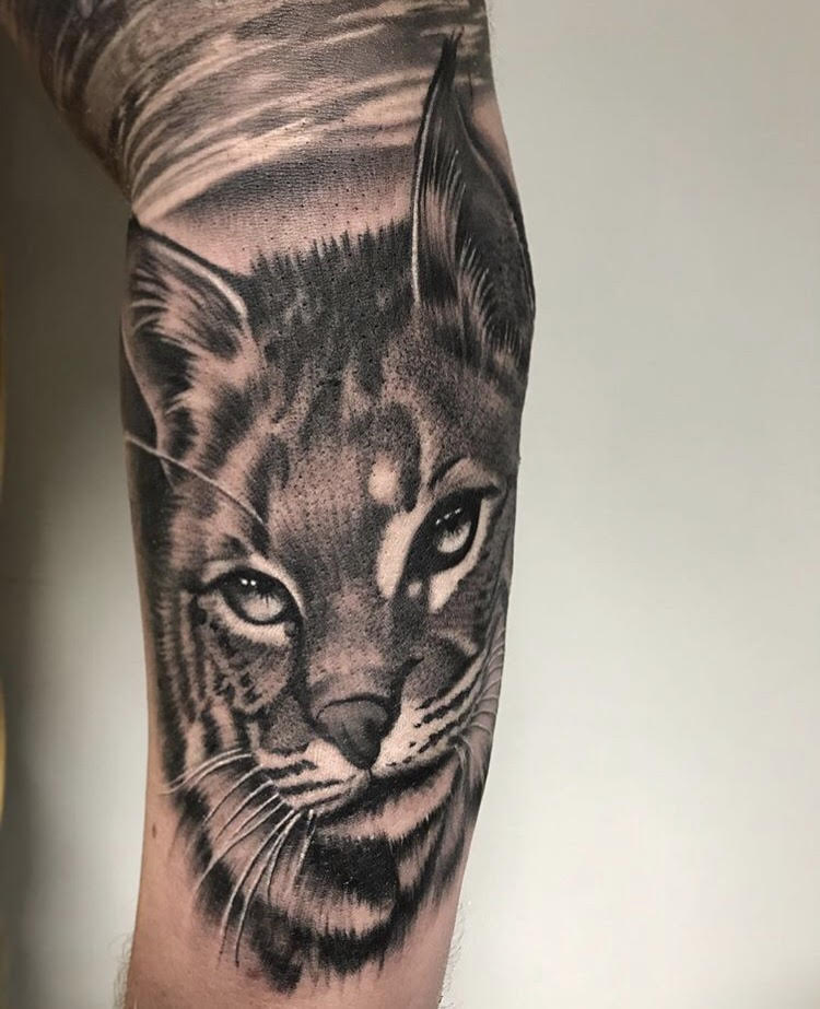 Custom Black and Grey Wild Feline Portrait Tattoo by Salvador Diaz at Certified Tattoo Studios Denver Co.jpg