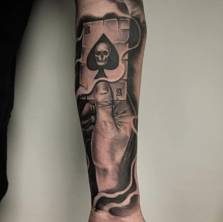 Custom Black and Grey Hand and Playing Card Tattoo by Salvador Diaz at Certified Tattoo Studios Denver Co.jpg