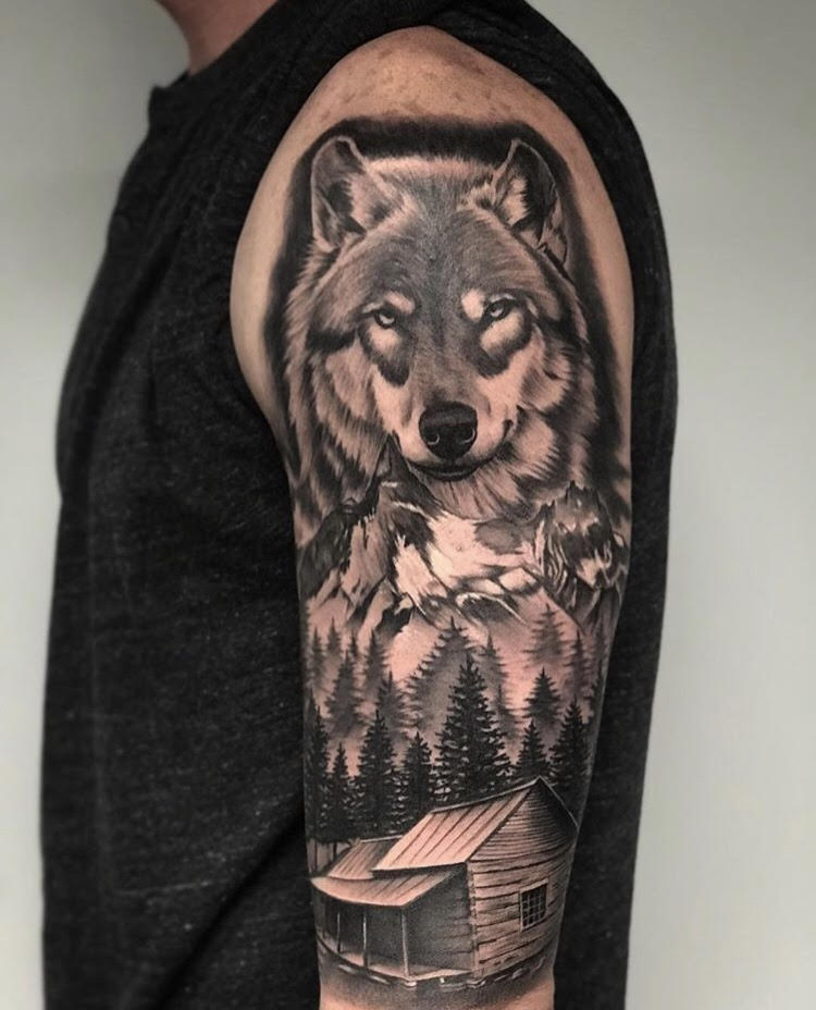 Custom Black and Grey Wolf in the Mountains Tattoo by Salvador Diaz at Certified Tattoo Studios Denver Co.jpg