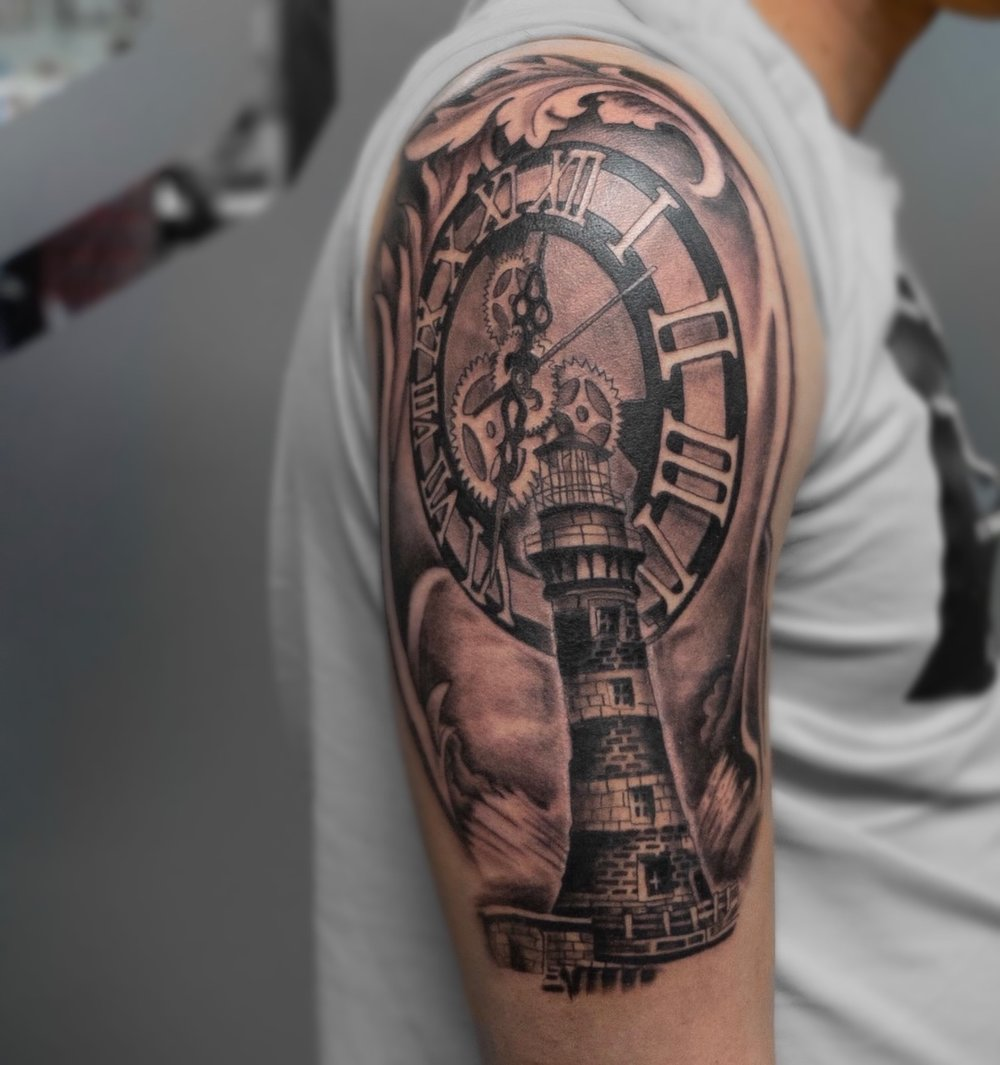 Custom Black and Grey Light House and Clock Tattoo by Ruben at Certified Tattoo Studios Denver Co.jpg