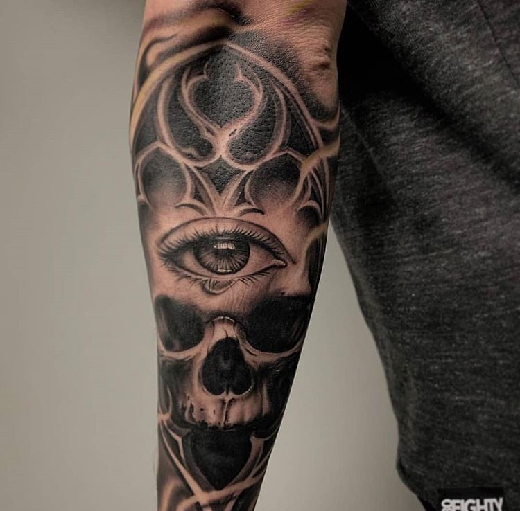Custom Black and Grey Skull and Eye Tattoo by Salvador Diaz  at Certified Tattoo Studios Denver CO.jpeg
