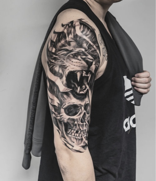 Custom Black and Gray Lion and Skull Tattoo by Greg at Certified Tattoo Studios Denver Co.jpg