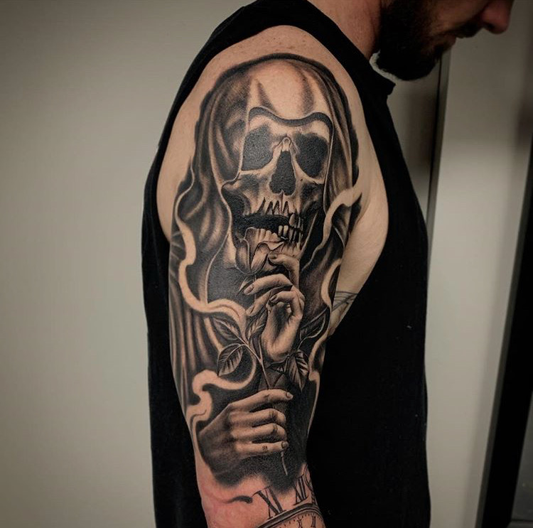 Custom Black and Grey Grim Reaper Holding a Rose in Smoke Tattoo by Salvador Diaz at Certified Tattoo Studios Denver Co.JPG