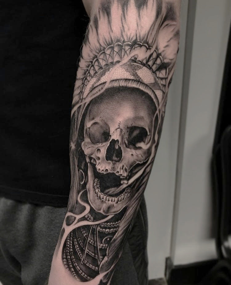 Custom Black and Grey Skull in a Native Head Piece with Smoke Tattoo by Ramon at Certified Tattoo Studios Denver Co.jpg