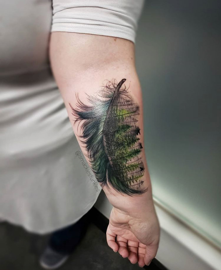 Custom Illustartive Green Feather transitionsing into Trees Tattoo by David Perea at Certified Tattoo Studios denver Co .JPG