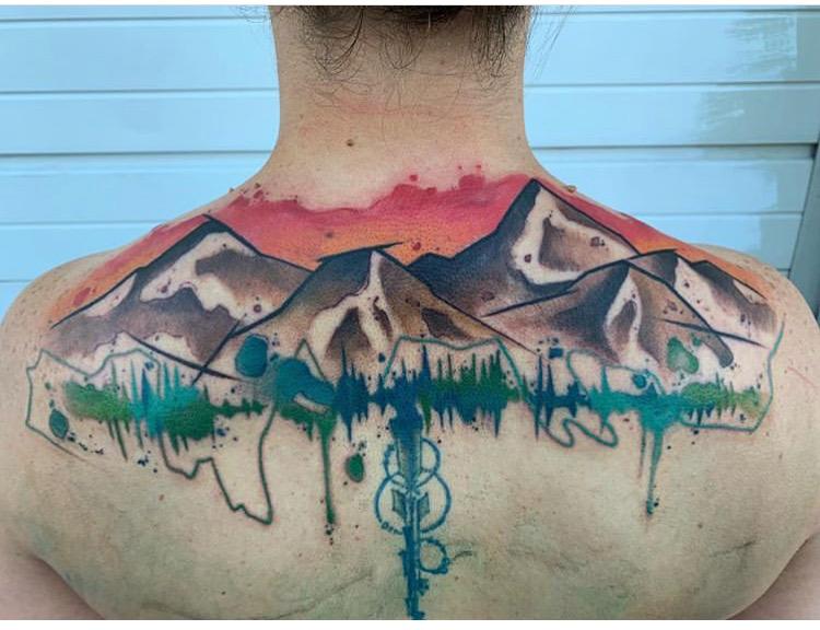 Custom Water Color Mountain Scene Back Tattoo by Skyler Espinoza at Certified Tattoo Studios Denver CO .JPG