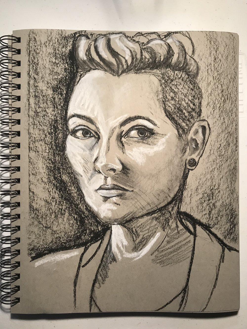 I am getting back into the swing of drawing from life.  Slowly and surely.  I've not worked on toned paper in ages, so this was a good exercise.  I'm going to keep working in this sketch book with portrait studies like this one.    Tuesday, October 9, 2018