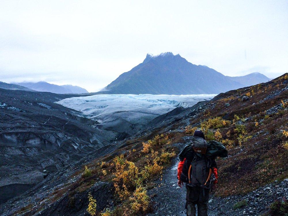 pending ice climb in a glacier