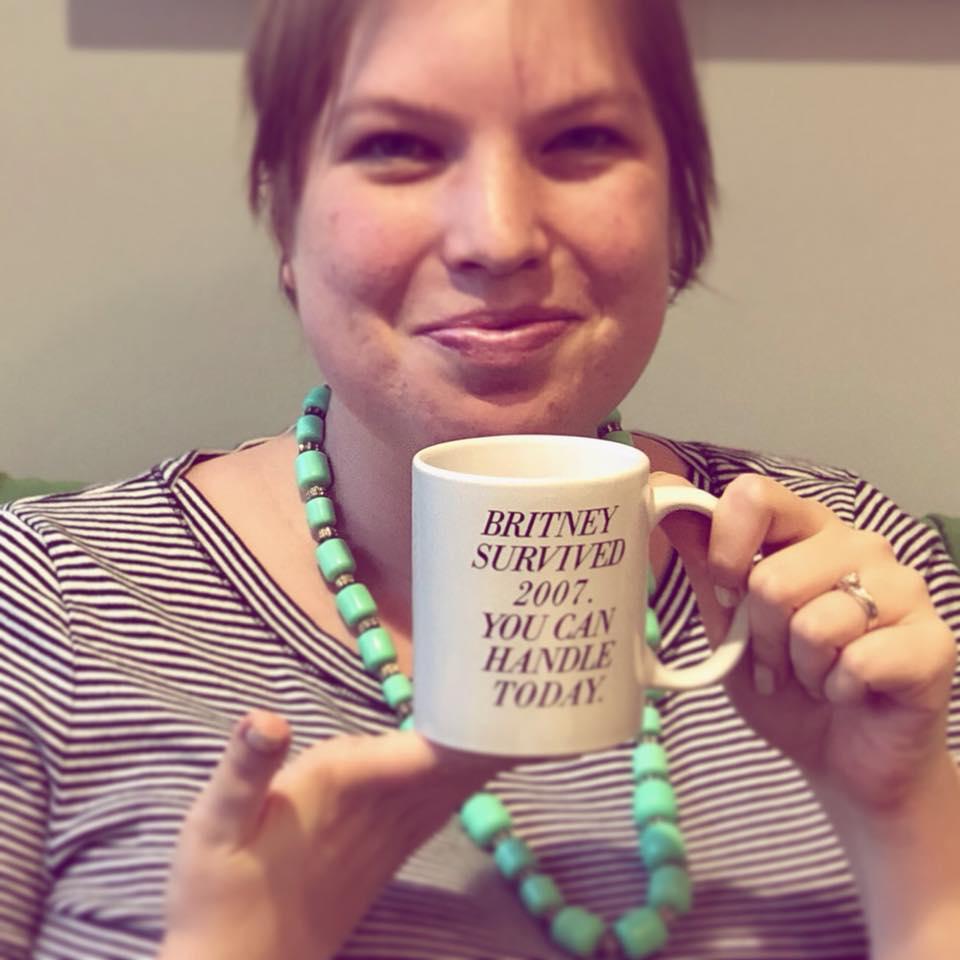 woman, striped dress, statement necklace, coffee mug, Britney Spears
