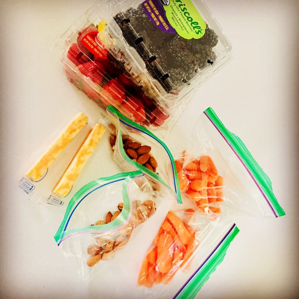 Healthy snacks on the go… Black berries, strawberries, cheese, nuts, carrots.