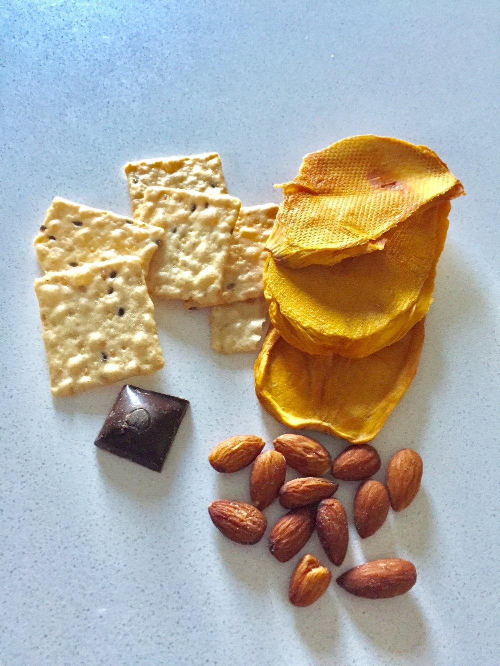 Snack: Rice crackers, dry mango, nuts, dark chocolate.