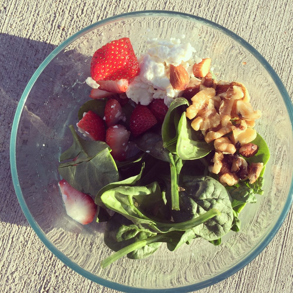 Strawberries, feta cheese, nuts and spinach.